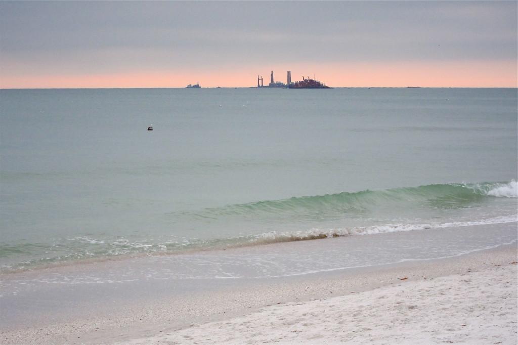 Offshore dredge pumps sand onshore