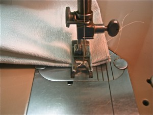 line up the pleat, lower foot and needle